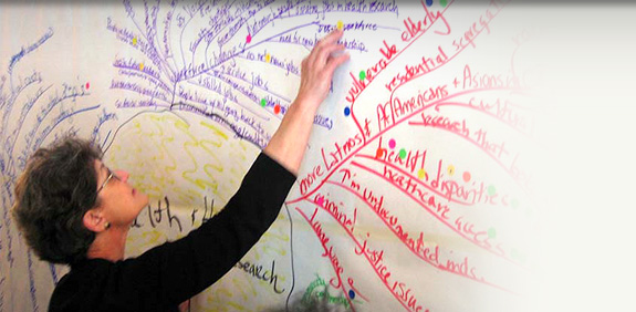 Woman drawing on a chalkboard